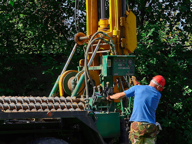 Auger type drill rig for mapping bedrock