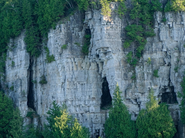 FAQs : can groundwater dissolve dolomite? The voids seen along Lake Michigan's cliff face in Door Co. is evidence of how groundwater flows through bedrock dissolving the dolomite. FAQs